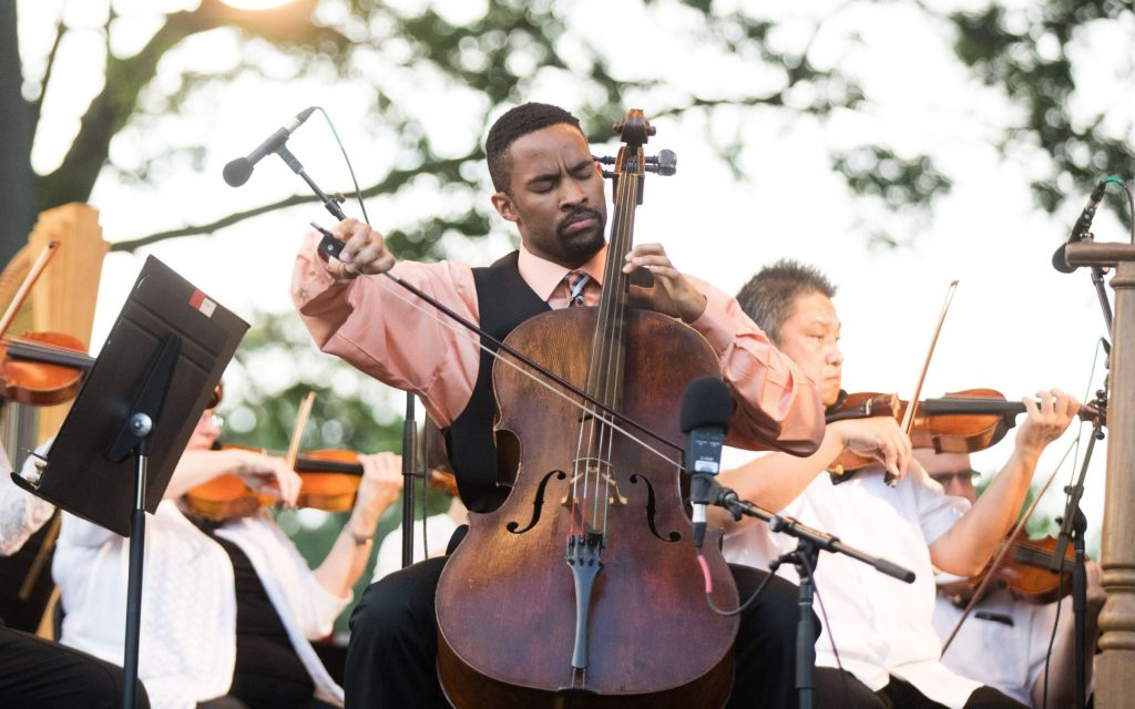 Cellist and TDP alumnus Khari Joyner solos with the ASO at Piedmont Park in 2018