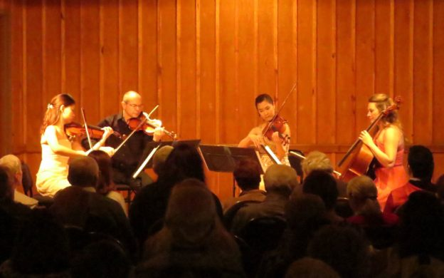 """The String Quartet No. 1 of Czech composer Leoš Janáček closed the first half of the program. It was inspired by Leo Tolstoy's novella, The Kreutzer Sonata, which was itself inspired by Beethoven's Violin Sonata No. 9, familiarly known as the """"Kreutzer Sonata,"""" because Beethoven dedicated it to the French violinist and composer Rodolphe Kreutzer. However, Kreutzer never played Beethoven's piece. It was originally dedicated to violinist George Bridgetower, who premiered it with Beethoven, but immediately after the concert, over a few drinks, Bridgetower insulted the moral behavior of a woman whom Beethoven adored. Enraged, Beethoven changed the dedication. Needless to say, as a title for Tolstoy's story, The Bridgetower Sonata would not have had the same ring to it. So we can thank Beethoven for his passion of the moment. That theme actually brings us directly to Tolstoy's story, which inspired artists other than Janáček, including visual artist René François Xavier Prinet, whose famous 1901 painting, Kreutzer Sonata, was also based on Tolstoy's novella. It has also inspired multiple adaptations for theater, film, radio and television. Tolstoy's novella itself, which was published in 1889, was certainly controversial for its era. It was swiftly censored in Russia, but became circulated in mimeographed form. An English translation eventually reached America and was banned. In 1890 the U.S. Post Office prohibited mailing of serialized versions printed in newspapers. Even president Theodore Roosevelt called Tolstoy a """"sexual moral pervert."""" The ban on the sale of the novella was eventually struck down by courts. In the midst of its deep first-person examination of jealousy and rage, Tolstoy argues for an ideal of sexual abstinence. Pozdnyshev, the narrating main character, relates the events of his deteriorating marriage leading up to killing his wife, a amateur pianist, when he believed he had caught her in an adulterous relationship with a male violinist — with whom s"""