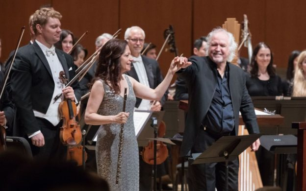"ASO principal flute Christina Smith takes a bow with conductor Donald Runnicles after performing Leonard Bernstein's ""Halil."" (credit: Jeff Roffman)"