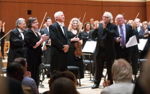 Retiring ASO players, violinist Carol Ramirez and principal horn Brice Andrus, with principal guest conductor Donald Runnicles and music director Robert Spano. (credit: Jeff Roffman)