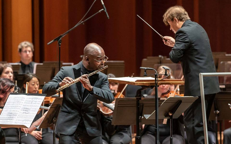 "Flutist Demarre McGill solos in Marc-André Dalbavie's ""Flute Concerto"" on April 18, 2019, with the Seattle Symphony, Ludovec Morlot conducting. It's one of four works by Dalbavie featured on the Seattle Symphony's latest CD. (credit: James Holt)"