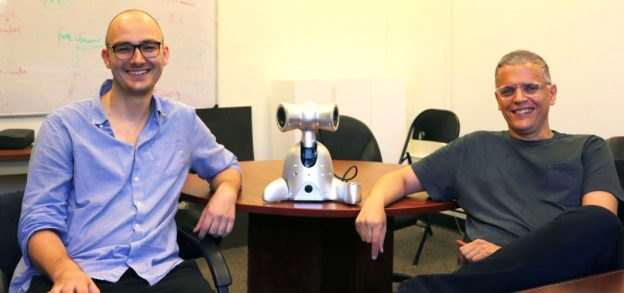 GaTech Center for Music Technology director Gil Weinberg and PhD candidate Richard Savery pose with a Shimi robot. (source: Georgia Tech)