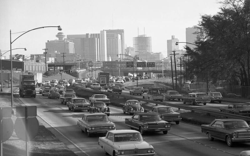The Atlanta skyline in 1968, looking south along the expressway toward North Avenue and the downtown skyline. The Equitable Building is the skyscraper under construction. (source: Atlanta Time Machine)]