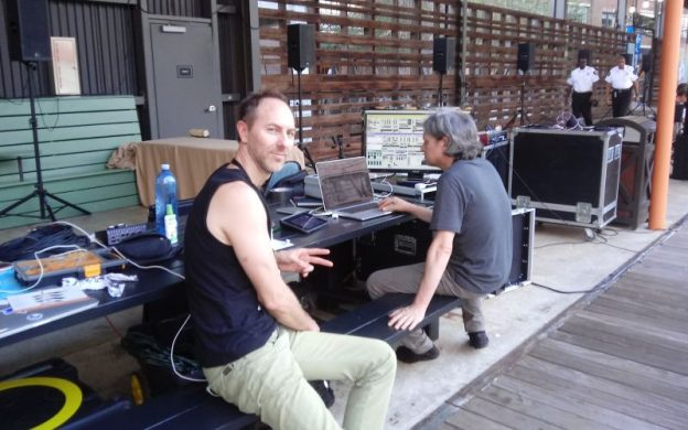 "Kai Riedl and Eric Marty at the control station for their soundscape installation, ""Turbulence,"" in The Shed, which overlooks the Atlanta Beltline at Ponce City Market. (photo: Mark Gresham)"