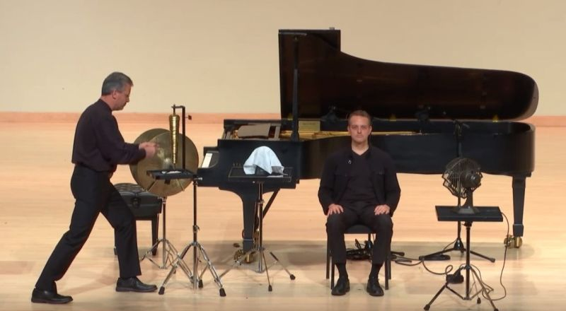 """percussionist John Lawless (left) joined Robert Henry in performing Henry's """"Cymbally Eyemazing."""" (source: live video stream capture)"""