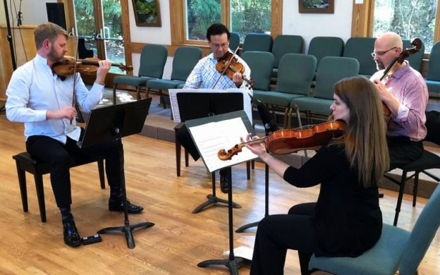 "Clockwise from left: violinists Justin Bruns and Kenn Wagner, cellist Joel Dallow and violist Jessica Oudin performing Caroline Shaw's ""Valencia."""