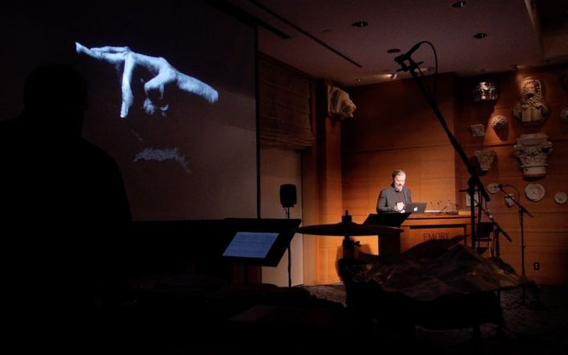 """The image of a hand looms over the performance of """"Hand"""" by Eve de Castro-Robinson."""