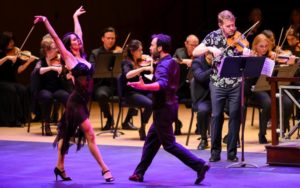 "Tango dancers Eva Lucero and Patricio Touceda shared the downstage spotlight with violinist Justin Bruns in Astor Piazzolla's ""Las Cuatro Estaciones Porteñas"" (credit: Rand Lines)"
