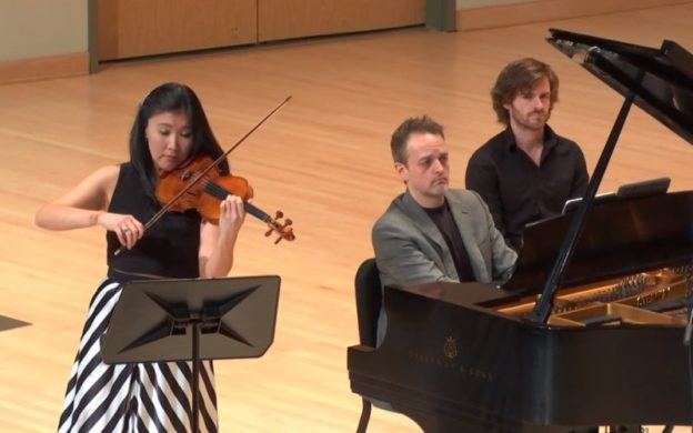 Violinist Helen Kim and pianist Robert Henry perform at Morgan Hall in KSU's Bailey Performance center. (source: video stream capture)