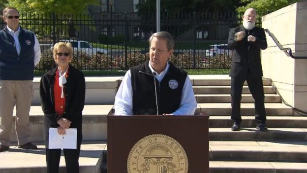 Georgia Governor Brian Kemp addresses the media in Liberty Park, near the State Capitol inn downtown Atlanta. (source: still image from Facebook video.)