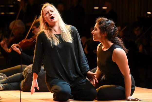 """Lucy Crowe and Sophia Burgos in the LSO's 2019 semi-staged production of Janáčeks """"The Cunning Little Vixen."""" (credit: Mark Allan)"""