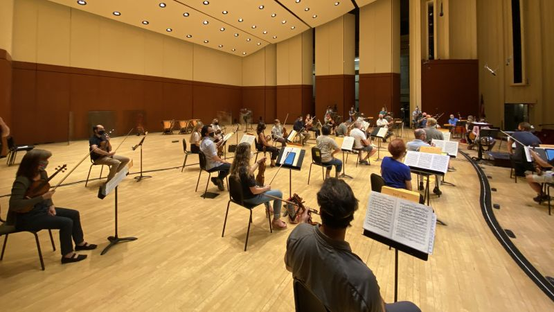 A reduced and socially distanced ASO string section rehearses on September 18.