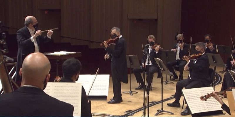 "Robert Spano conducting, Gil Shaham, violin soloist in Beethoven's ""Violin Concerto."" (screen capture)"