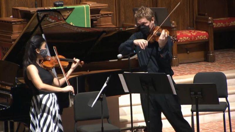Violinists Helen Hwaya Kim and David Coucheron perform Wieniawski's Étude-caprice No. 1 (video frame capture)