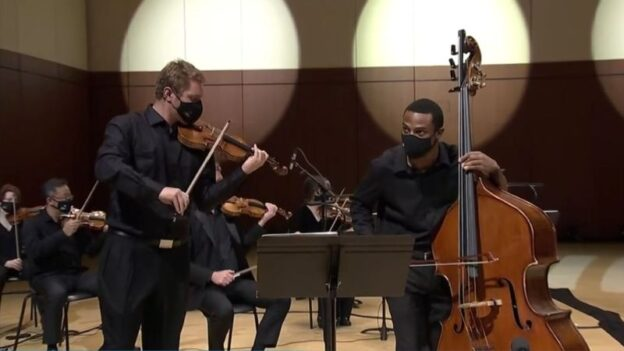 "Violinist David Coucheron and double-bassist Xavier Foley share the spotlight in Foley's ""For Justice and Peace"" (source: ASO video fame capture)"