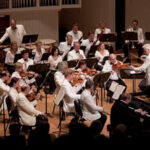 Michael Palmer leads the Bellingham Festival Orchestra in a concert with pianist Horacio Gutiérrez in 2010. (source: Bellingham Festival of Music)