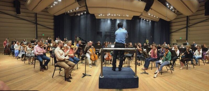 Jerry Hou in rehearsal at Grand Teton Music Festival. (source: jerryhou.com)