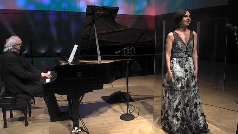 """O'Connor and Runnicles perform """"Trois Chansons de Bilitis"""" by Claude Debussy. (video frame/ASO)"""