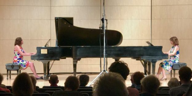 Piano duo Christi and Jennifer, from a previous OCMS concert. (source: Facebook)
