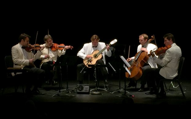 Guitarist Jason Vieaux (center) in performance with the Escher String Quartet.
