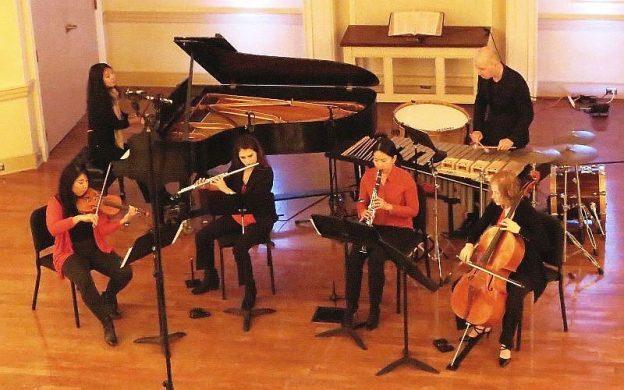 "l-r: Choo Choo Hu, piano, Grace Kawamura Stubbart, violin, Nicole Frankel, flute, Jiyeon Choi, clarinet, Joseph Petrasek percussion, and Laura Usiskin, cello, peform Louis Andriessen's ""Workers Union."" (credit: Mark Gresham)"
