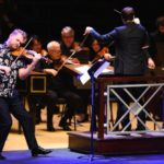 "Violinist Justin Bruns performs Astor Piazzolla's """" with the conductor Stepehen Mulligan and the Atlanta Symphony Orchestra. (credit: Tango dancers Eva Lucero and Patricio Touceda shared the downstage spotlight with violinist Justin Bruns in Astor Piazzolla's ""Las Cuatro Estaciones Porteñas."" (credit: Rand Lines)"
