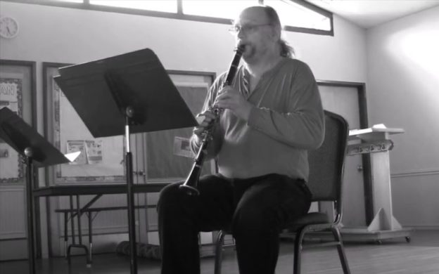 "Karl Henning plays his extended solo clarinet piece, ""Thpreau in Concord Jail."" (image from video still)"