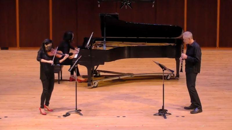 "Violinist Helen Hwaya Kim, pianist Erika Tazawa, and clarinetist Ted Gurch perform ""Jasper Drag"" by Atlanta composer Alvin Singleton. (source: video frame capture / GSU)"
