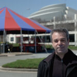 The Atlanta Opera's general and artistic director Tomer Zvulun, with The BIg Tent and the Cobb Energy Centre in the background. (credit: Felipe Barral / TAO)