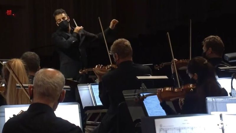 Masks on for string players: James Gaffigan conducts the ASO. (video frame / ASO)