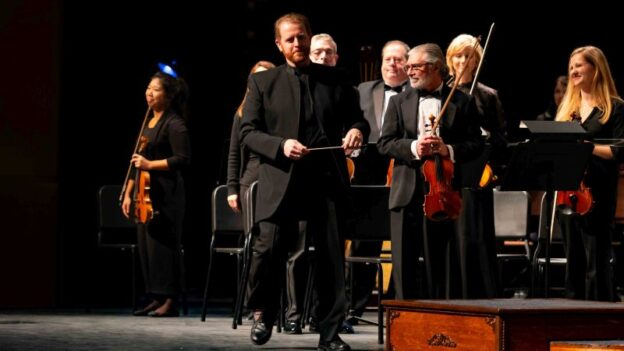 Music director and conductor Timothy Verville (center) will lead the Georgia Symphony Orchestra in its upcoming 71st concert season. (image: GSO)