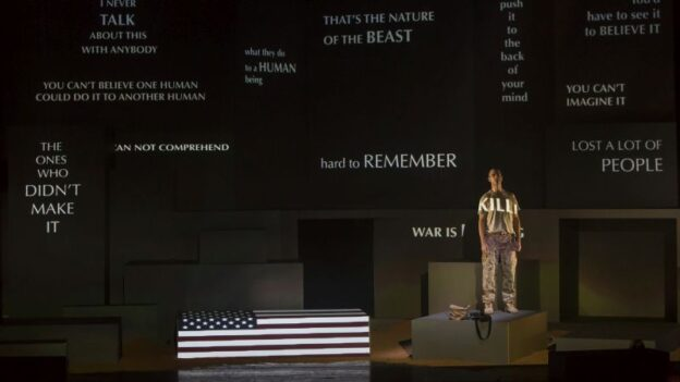 """A scene from The Atlanta Opera's November 2015 production of """"Soldier Songs"""" with baritone David Adam Moore as the Soldier. (Raftermen)"""